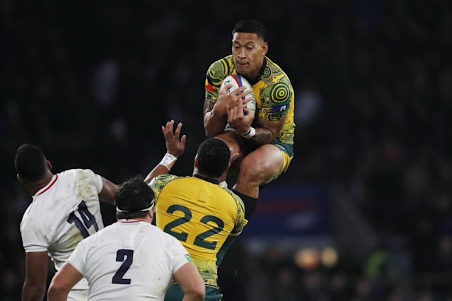 Australia's full-back Israel Folau (R) catches the ball during the international rugby union test match between England and Australia at Twickenham stadium in south-west London on November 24, 2018. (Photo by Adrian DENNIS / AFP) (Photo credit should read ADRIAN DENNIS/AFP/Getty Images)