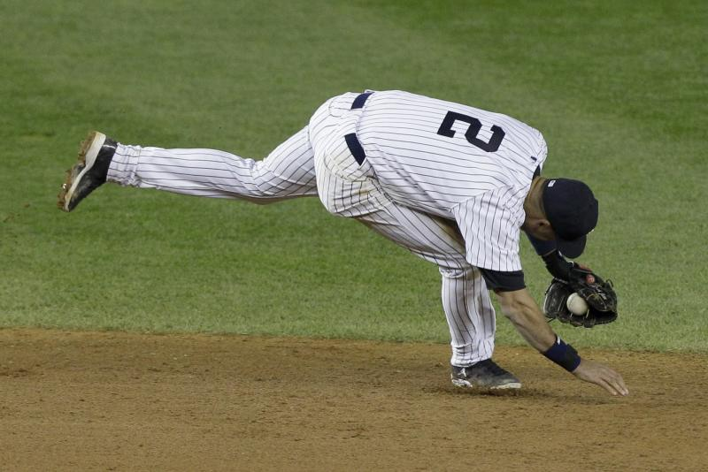New York Yankees shortstop Derek Jeter injures himself fielding a ball in the 12th inning of Game 1 of the American League championship series against the Detroit Tigers early Sunday, Oct. 14, 2012, in New York. (AP Photo/Kathy Willens)