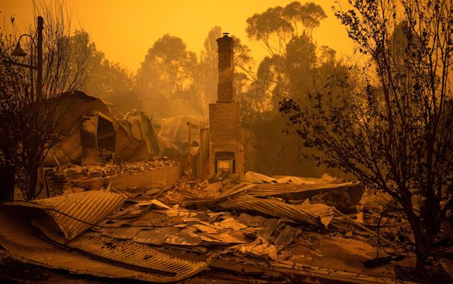 The remains of burnt-out buildings are seen in the New South Wales town of Cobargo after bushfires ravaged the town (AFP via Getty Images)