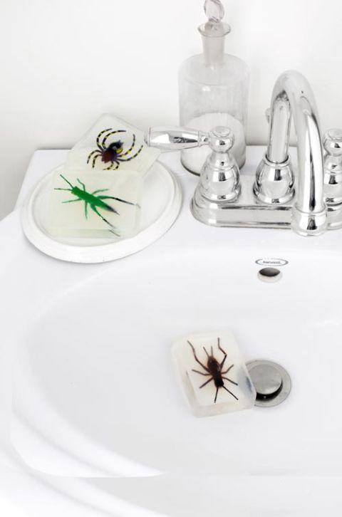 """<p>Washing your hands has never been more frightful. Use plastic bugs to create these creepy soaps for your bathroom. <br></p><p><em>Get the tutorial at <a href=""""http://www.countryliving.com/diy-crafts/g1189/best-halloween-crafts-ever/?slide=27"""" rel=""""nofollow noopener"""" target=""""_blank"""" data-ylk=""""slk:Country Living"""" class=""""link rapid-noclick-resp"""">Country Living</a>.</em><br><br></p><p><strong>What You'll Need: </strong>Plastic spiders ($7, Amazon); <a href=""""https://www.amazon.com/Starter-Silicone-1-Spatula-Eco-Friendly/dp/B089DDX787/ref=sr_1_19_sspa?dchild=1&keywords=soap+making+kit&qid=1595003776&sr=8-19-spons&psc=1&spLa=ZW5jcnlwdGVkUXVhbGlmaWVyPUEyNVhCOUdWVDhVSjAwJmVuY3J5cHRlZElkPUEwMzUzOTI1M0hSSzhNTk1JQlA0UyZlbmNyeXB0ZWRBZElkPUEwMTc5NTc3Qk43RTdBMUZCVEM0JndpZGdldE5hbWU9c3BfbXRmJmFjdGlvbj1jbGlja1JlZGlyZWN0JmRvTm90TG9nQ2xpY2s9dHJ1ZQ%3D%3D&tag=syn-yahoo-20&ascsubtag=%5Bartid%7C10070.g.1279%5Bsrc%7Cyahoo-us"""" rel=""""nofollow noopener"""" target=""""_blank"""" data-ylk=""""slk:soap making kits"""" class=""""link rapid-noclick-resp"""">soap making kits </a>($49, Amazon)</p><p><br><br></p><p>Want more crafts? You're in luck! <a href=""""https://subscribe.hearstmags.com/subscribe/womansday/253396?source=wdy_edit_article"""" rel=""""nofollow noopener"""" target=""""_blank"""" data-ylk=""""slk:Subscribe to Woman's Day"""" class=""""link rapid-noclick-resp"""">Subscribe to Woman's Day</a> today and get <strong>73% off your first 12 issues</strong>. And while you're at it, <a href=""""https://subscribe.hearstmags.com/circulation/shared/email/newsletters/signup/wdy-su01.html"""" rel=""""nofollow noopener"""" target=""""_blank"""" data-ylk=""""slk:sign up for our FREE newsletter"""" class=""""link rapid-noclick-resp"""">sign up for our FREE newsletter</a> for even more of the Woman's Day content you want.<br></p>"""