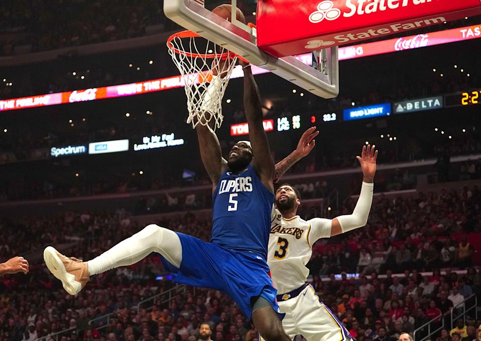 Clippers' Montrezl Harrell is defended by Lakers' Anthony Davis on March 8, 2020 in Los Angeles.