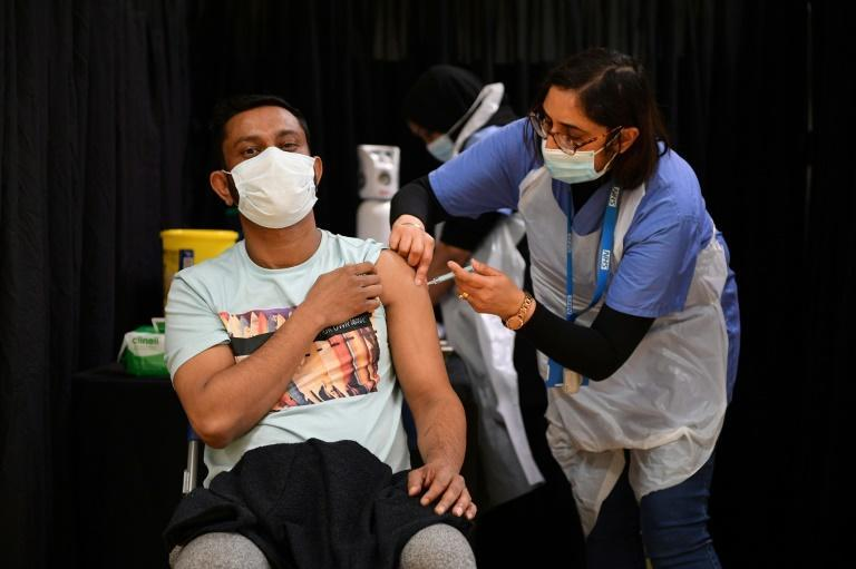 A health worker gives a Covid injection to a patient at a temporary vaccination centre set up at the East London Mosque in the British capital