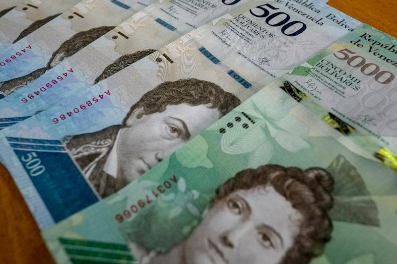 Venezuelan 500 and 5000-Bolivar notes are pictured in Caracas on January 16, 2017; the country's sky-high inflation rate soared to 24,571 percent between May 2017 - May 2018