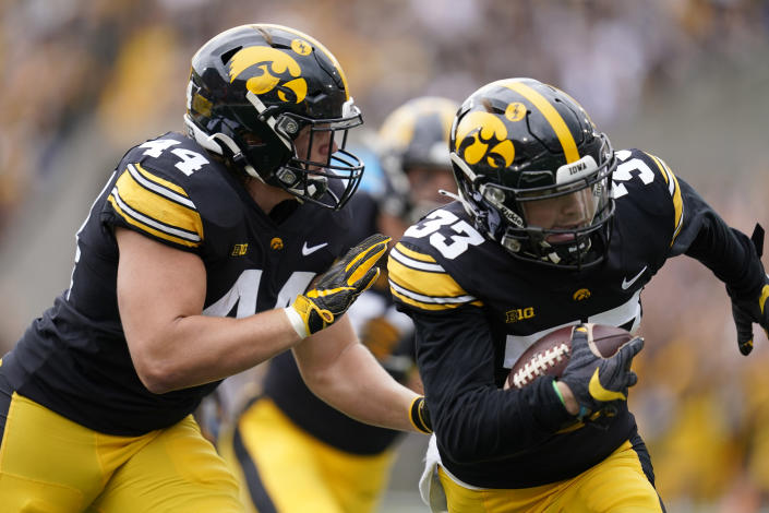 Iowa defensive back Riley Moss (33) returns an interception 30-yards for a touchdown during the first half of an NCAA college football game against Indiana, Saturday, Sept. 4, 2021, in Iowa City, Iowa. (AP Photo/Charlie Neibergall)