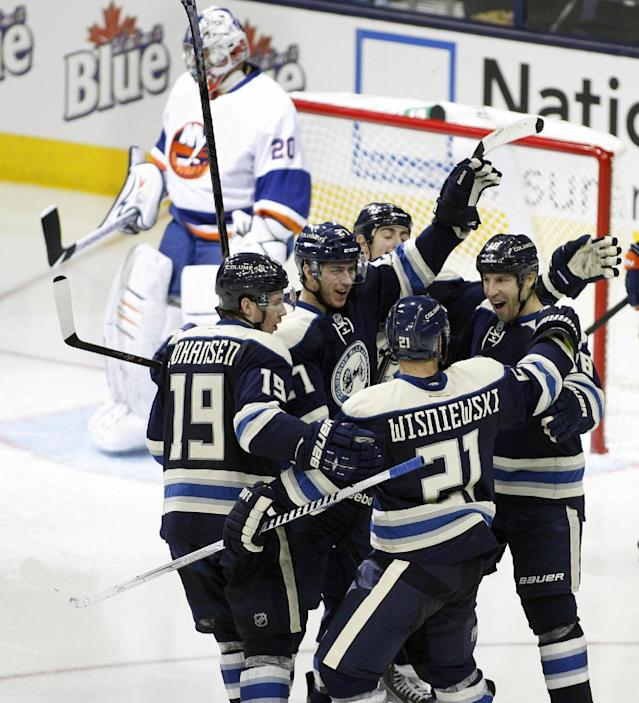 Columbus' RJ Umberger (18), right, celebrates after scoring against the New York Islanders in the third period of an NHL hockey game Saturday, Nov. 9, 2013, in Columbus, Ohio. (AP Photo/Mike Munden)