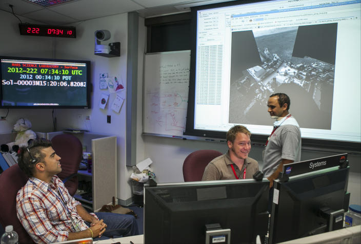 """In this photo taken Thursday, Aug. 9, 2012, Bobak Ferdowsi, a flight director for the Mars Curiosity rover, is seen at his workstation at NASA's JPL in Pasadena, Calif. Known to the Twitterverse and the president of the United States as """"Mohawk Guy,"""" Ferdowski could be the changing face of NASA and all of geekdom. (AP Photo/Damian Dovarganes)"""
