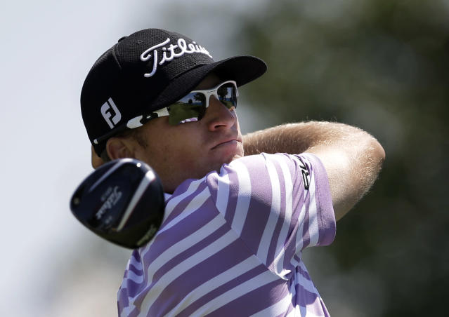 Morgan Hoffman watches his shot off of the 18th tee during the second round of the Byron Nelson Championship golf tournament, Friday, May 16, 2014, in Irving, Texas. (AP Photo/Tony Gutierrez)