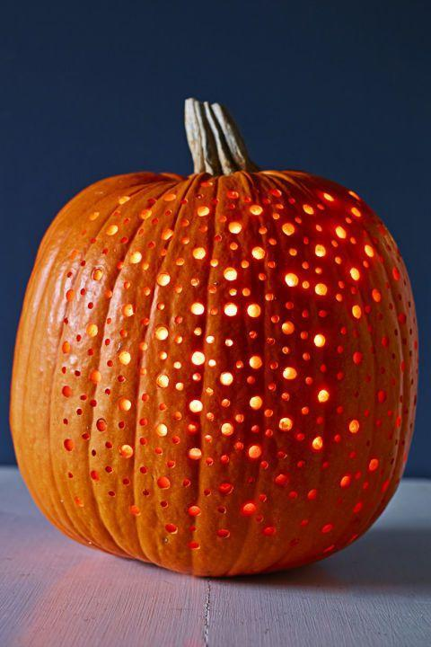 "<p>It may <em>look</em> elaborate, but this polka-dot pattern is really very easy.</p><p><strong> Make Easy Twinkling Dots Pumpkin: </strong>Lightly draw your pattern on a pumpkin, leaving enough space between dots so holes won't overlap. Punch it out with a <a href=""https://www.amazon.com/BLACK-DECKER-LDX120C-Lithium-Driver/dp/B005NNF0YU/ref=sr_1_2"" rel=""nofollow noopener"" target=""_blank"" data-ylk=""slk:power drill"" class=""link rapid-noclick-resp"">power drill</a> and various size bits. A detailed design shines brighter by placing <a href=""https://www.amazon.com/RTGS-Sets-White-Lights-Silver/dp/B00VFMC5GE/?linkCode=ogi&tag=goodhousekeeping_auto-append-20&ascsubtag=[artid