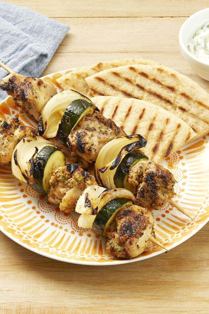 """<p>Here's an interesting tip for working with wooden skewers: Soak them in water for at least 30 minutes ahead of time to avoid scorching the wood.</p><p><strong><a href=""""https://www.thepioneerwoman.com/food-cooking/recipes/a32529701/greek-chicken-kebabs-recipe/"""" rel=""""nofollow noopener"""" target=""""_blank"""" data-ylk=""""slk:Get the recipe"""" class=""""link rapid-noclick-resp"""">Get the recipe</a>.</strong></p><p><strong><strong><a class=""""link rapid-noclick-resp"""" href=""""https://go.redirectingat.com?id=74968X1596630&url=https%3A%2F%2Fwww.walmart.com%2Fbrowse%2Fhome%2Fserveware%2Fthe-pioneer-woman%2F4044_623679_639999_2347672&sref=https%3A%2F%2Fwww.thepioneerwoman.com%2Ffood-cooking%2Fmeals-menus%2Fg32188535%2Fbest-grilling-recipes%2F"""" rel=""""nofollow noopener"""" target=""""_blank"""" data-ylk=""""slk:SHOP PLATTERS"""">SHOP PLATTERS</a></strong></strong></p>"""