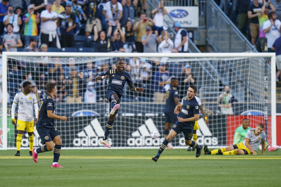 Philadelphia Union's Jamiro Monteiro. center, leaps as he celebrates his goal during the first half of an MLS soccer match against the Columbus Crew, Wednesday, June 23, 2021, in Chester, Pa. (AP Photo/Chris Szagola)