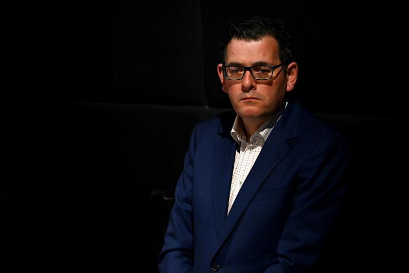Victorian Premier Daniel Andrews looks on whilst speaking to the media in Melbourne.