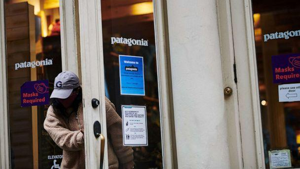 PHOTO: A customer exits a Patagonia Inc. store in the SoHo neighborhood of New York, Dec. 14, 2020.  (Gabby Jones/Bloomberg via Getty Images)