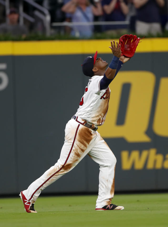Atlanta Braves left fielder Ronald Acuna Jr. celebrates at the end of the team's baseball game against the Chicago Cubs on Wednesday, May 16, 2018, in Atlanta. The Braves won 4-1. (AP Photo/John Bazemore)