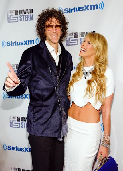 "Satellite radio talk show host Howard Stern and wife Beth Stern arrive at ""Howard Stern's Birthday Bash,"" presented by SiriusXM, at the Hammerstein Ballroom on Friday, Jan. 31, 2014, in New York. (Photo by Evan Agostini/Invision/AP)"