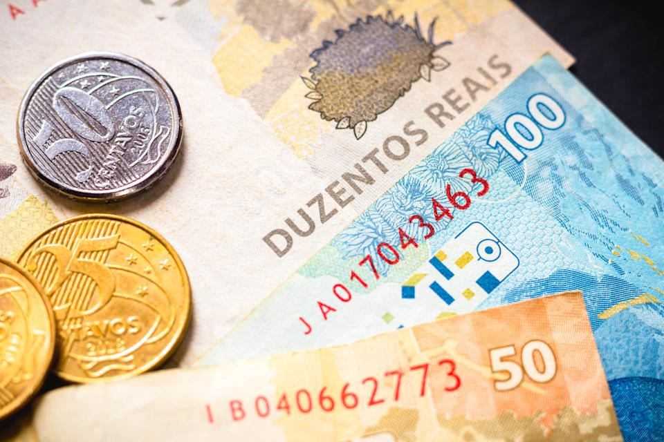 In this photo illustration the detail of the two hundred reais note and a few real coins, twenty-five cents. The Real is the current money in Brazil.