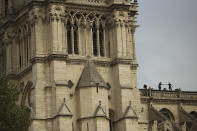 Technicians work on top of the Notre Dame cathedral in Paris, Monday, April 22, 2019. In the wake of the fire last week that gutted Notre Dame, questions are being raised about the state of thousands of other cathedrals, palaces and village spires that have turned France — as well as Italy, Britain and Spain — into open air museums of Western civilization. (AP Photo/Francisco Seco)
