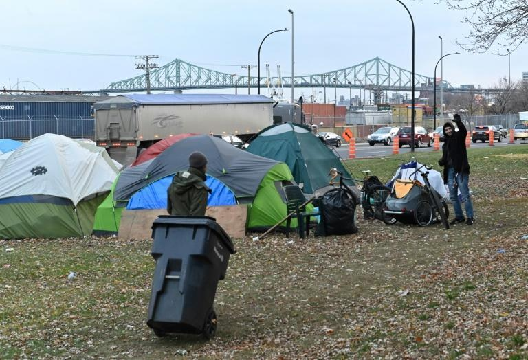 A homeless camp, set up in the summer of 2020 due to the coronavirus pandemic, lines a busy Montreal boulevard