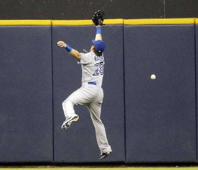 Toronto Blue Jays' Colby Rasmus can't catch a double hit by Milwaukee Brewers' Jonathan Lucroy during the third inning of a baseball game Tuesday, Aug. 19, 2014, in Milwaukee. (AP Photo/Morry Gash)
