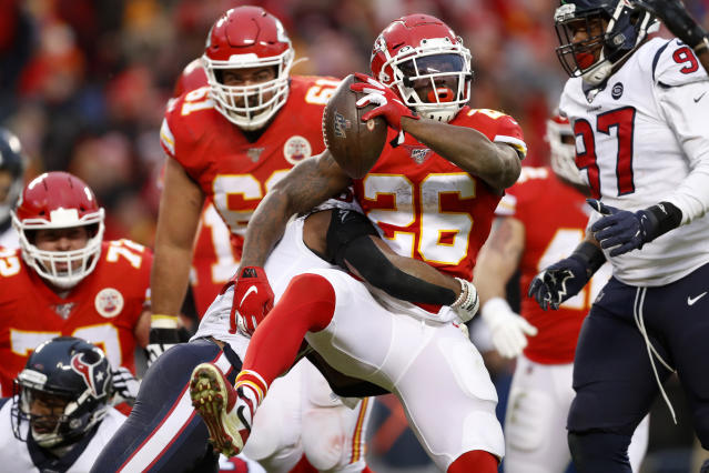 Kansas City Chiefs running back Damien Williams (26) scores a touchdown past Houston Texans safety Justin Reid (20) during the second half of an NFL divisional playoff football game, in Kansas City, Mo., Sunday, Jan. 12, 2020. (AP Photo/Jeff Roberson)