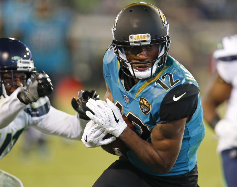 Jacksonville Jaguars wide receiver Dede Westbrook (12) catches an 18-yard pass for a touchdown in front of Seattle Seahawks cornerback Byron Maxwell, left, during the second half of an NFL football game, Sunday, Dec. 10, 2017, in Jacksonville, Fla. (AP Photo/Stephen B. Morton)
