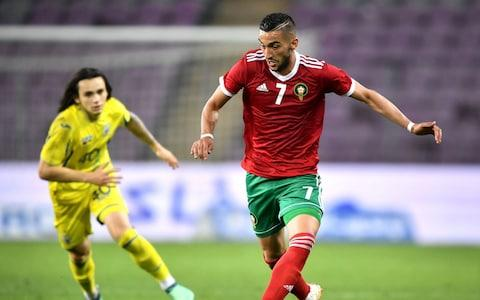 Morocco's midfielder Hakim Ziyech (R) controls the ball next to Ukraine's midfielder Mykola Shaparenko during the friendly match between Morocco and Ukraine - Credit: Getty Images
