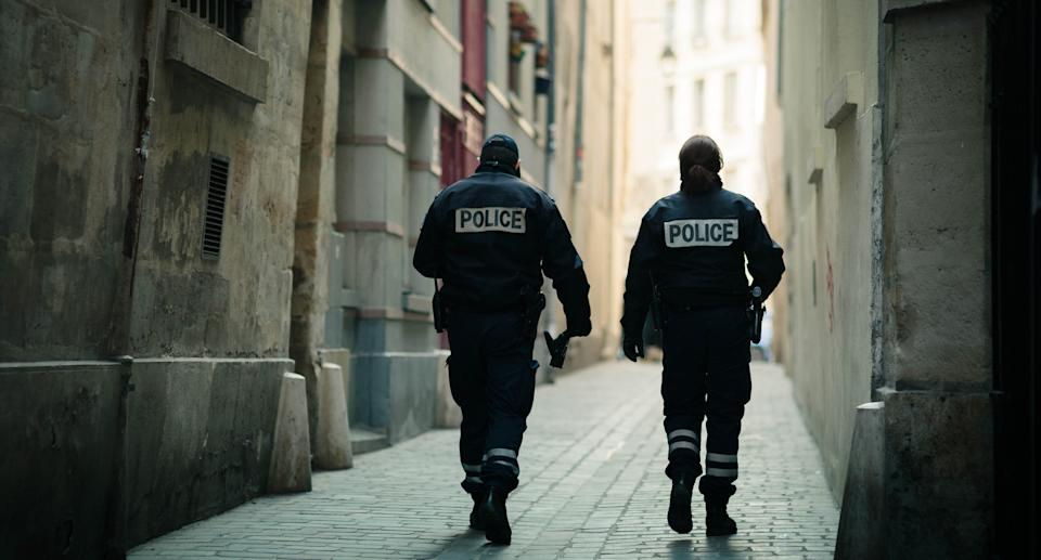 A pair of police officers with the word