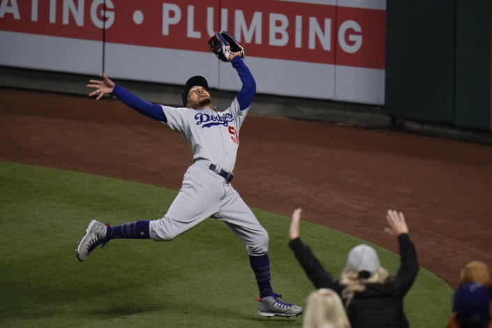 Los Angeles Dodgers' Mookie Betts catches a fly ball hit by Los Angeles Angels' Taylor Ward during the fourth inning of a baseball game, Friday, May 7, 2021, in Anaheim, Calif. (AP Photo/Jae C. Hong)