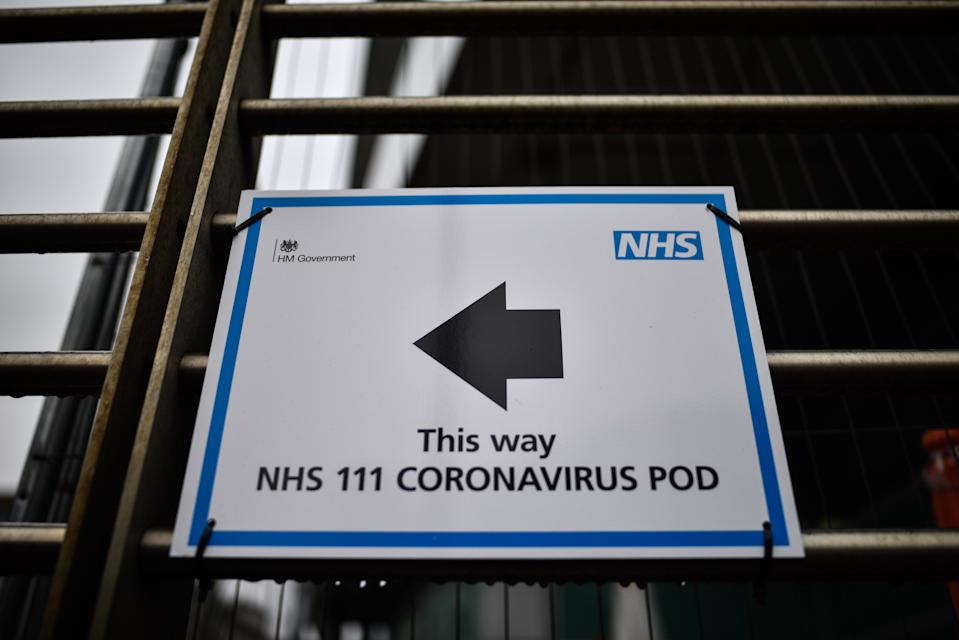 LONDON, ENGLAND - MARCH 04: A sign directing patients towards a Coronavirus pod at University College Hospital on March 4, 2020 in London, United Kingdom. NHS England has declared coronavirus a level four incident, the highest level of emergency preparedness planning, with 53 confirmed cases of the virus now in the UK. (Photo by Peter Summers/Getty Images)