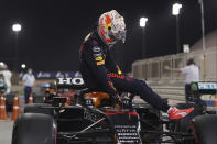 Red Bull driver Max Verstappen of the Netherlands steps out of his car after the qualifying for the Bahrain Formula One Grand Prix, at the Formula One Bahrain International Circuit in Sakhir, Bahrain, Saturday, March 27, 2021. The Bahrain Formula One Grand Prix will take place on Sunday. (Lars Baron, Pool via AP)
