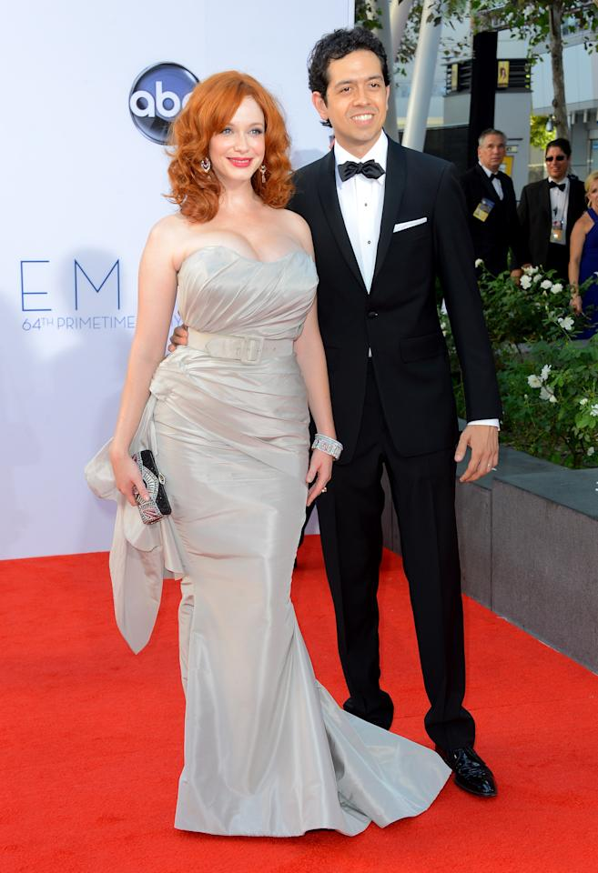 LOS ANGELES, CA - SEPTEMBER 23: Actors   Christina Hendricks (L) and Geoffrey Arend arrive at the 64th Annual Primetime Emmy Awards at Nokia Theatre L.A. Live on September 23, 2012 in Los Angeles, California.  (Photo by Frazer Harrison/Getty Images)