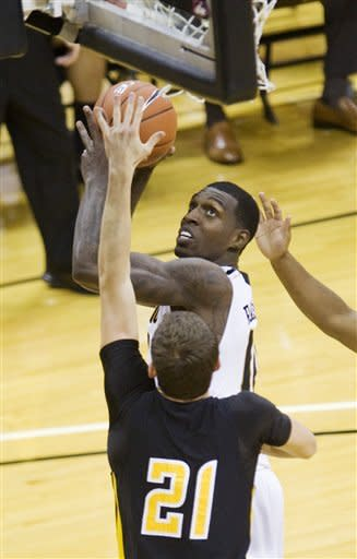 Missouri's Ricardo Ratliffe, top, shoots over Kennesaw State's Aaron Anderson, bottom, during the first half of an NCAA college basketball game on Thursday, Dec. 15, 2011, in Columbia, Mo. Missouri won the game 104-67. (AP Photo/L.G. Patterson)