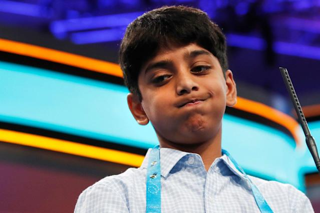<p>Ishaan Akula of Morganville, N.J., reacts after spelling his word incorrectly during the 90th Scripps National Spelling Bee in Oxon Hill, Md., Wednesday, May 31, 2017. (AP Photo/Jacquelyn Martin) </p>