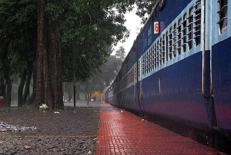 Monsoon clouds shower down rapidly, forcing passengers on the platform back into their coaches. Kulem is such a lovely station.