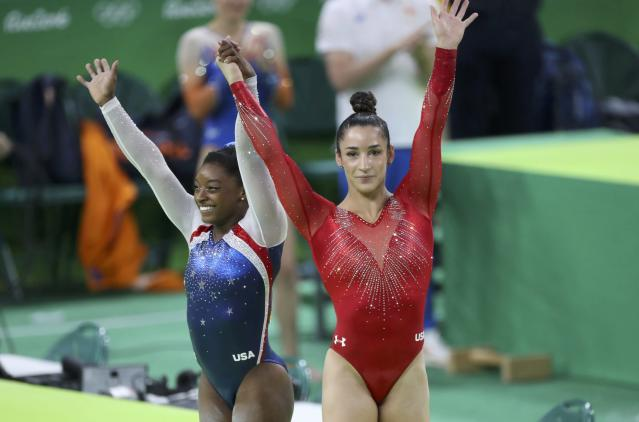 2016 Rio Olympics - Artistic Gymnastics - Final - Women's Individual All-Around Final - Rio Olympic Arena - Rio de Janeiro, Brazil - 11/08/2016. Silver medal winner Alexandra Raisman (USA) of the U.S. and gold medal winner Simone Biles (USA) of the U.S. celebrate. REUTERS/Damir Sagolj FOR EDITORIAL USE ONLY. NOT FOR SALE FOR MARKETING OR ADVERTISING CAMPAIGNS.