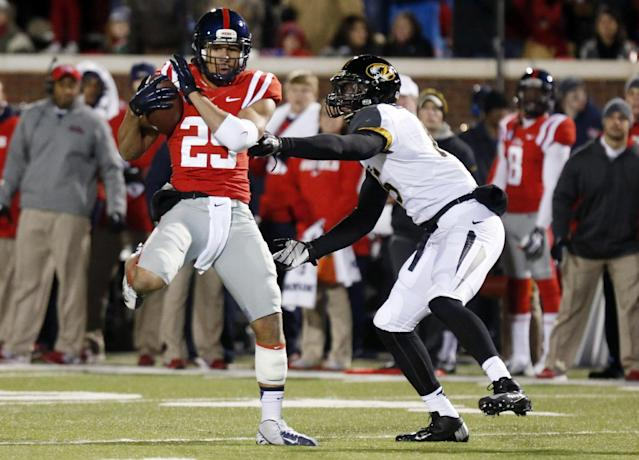 Mississippi defensive back Cody Prewitt (25) intercepts a pass meant for Missouri wide receiver Dorial Green-Beckham, right, in the second half of an NCAA college football game Saturday, Nov. 23, 2013, in Oxford, Miss. Missouri won 24-10. (AP Photo/Rogelio V. Solis)