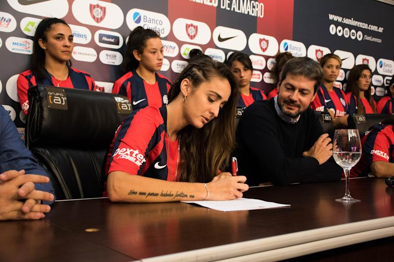 BUENOS AIRES, ARGENTINA - APRIL 12: Maca Sánchez signs her contract with San Lorenzo next to President of San Lorenzo Matías Lammens during the signing of the first professional contract in Argentina Women Football League on April 12, 2019 in Buenos Aires, Argentina. Sanchez headed women's claim for equality and professional contracts and had recently resigned from UAI Urquiza after being denied a professional contract. (Photo by Franco Fafasuli/Getty Images)