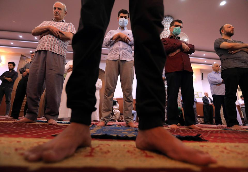 Muslims pray at a mosque in Arbil, in northern Iraq, May 13, 2020. (Safin Hamed/AFP via Getty Images)