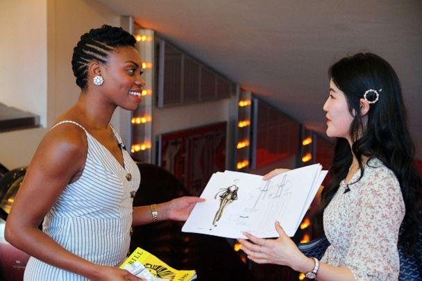 PHOTO: FIT student Ruby SeoHee Shin shows actress Adrienne Walker, who plays Nala in the Broadway production of 'The Lion King,' sketches for Nala-inspired garments. (Disney)