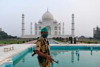 A security guard patrols at the Taj Mahal, which reopened on Monday for the first time since March