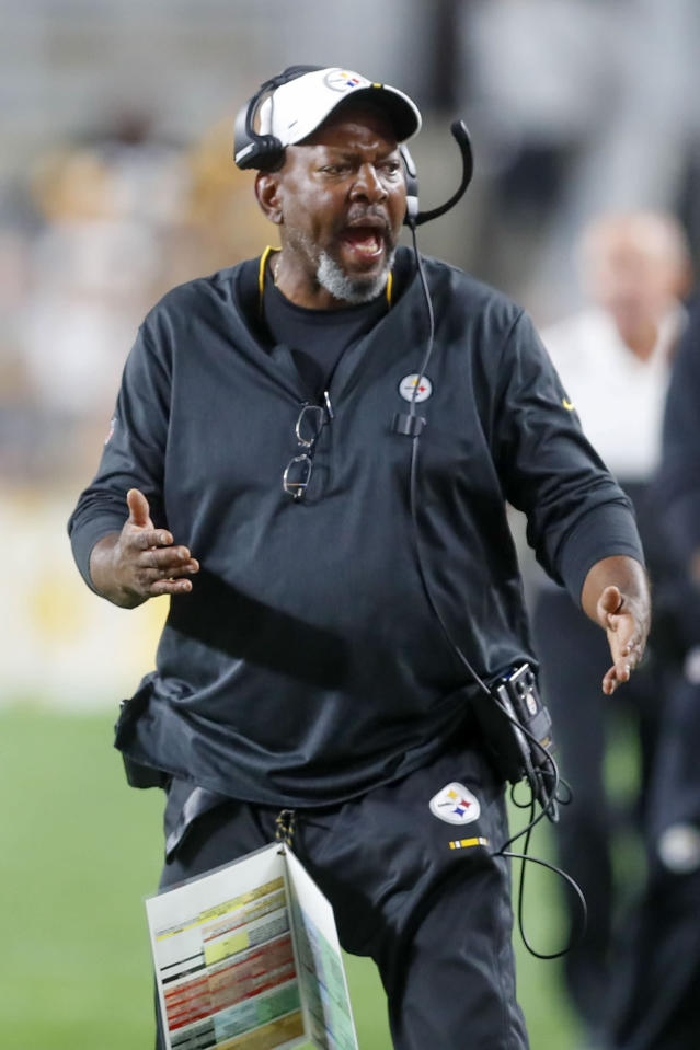In this photo from Friday, Aug. 9, 2019, Pittsburgh Steelers wide receivers coach Darryl Drake talks to a receiver during the second half of an NFL preseason football game against the Tampa Bay Buccaneers in Pittsburgh. The team said Drake, who joined the coaching staff in 2018, died early Sunday morning, Aug. 12, 2019. (AP Photo/Keith Srakocic)