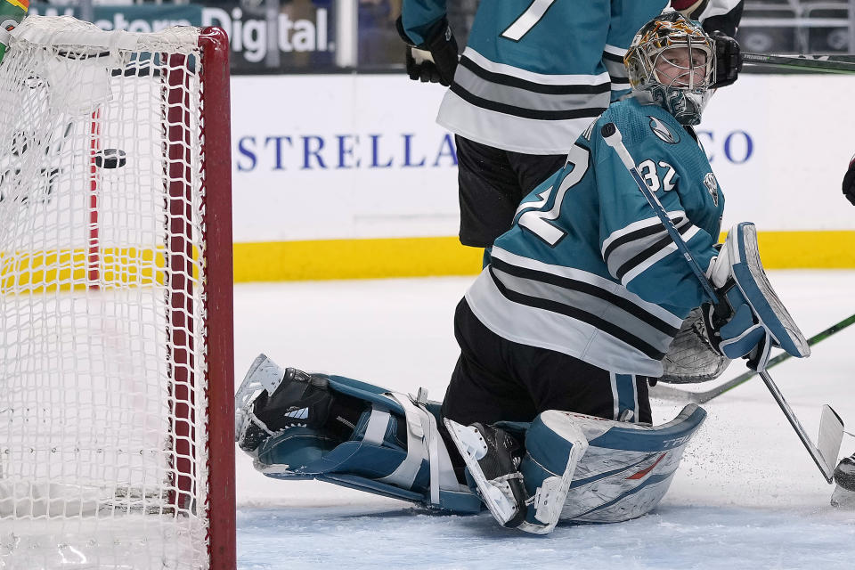 San Jose Sharks goaltender Josef Korenar looks back as he cannot stop a goal by Arizona Coyotes defenseman Victor Soderstrom during the second period of an NHL hockey game Friday, May 7, 2021, in San Jose, Calif. (AP Photo/Tony Avelar)