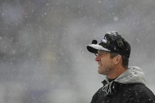 Baltimore Ravens head coach John Harbaugh watches action as snow falls in the first half of an NFL football game against the Minnesota Vikings, Sunday, Dec. 8, 2013, in Baltimore. (AP Photo/Nick Wass)