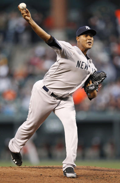 New York Yankees starting pitcher Ivan Nova throws against the Baltimore Orioles in the first inning of a baseball game in Baltimore, Monday, April 9, 2012. (AP Photo/Patrick Semansky)