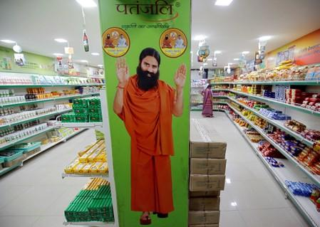A hoarding with an image of Baba Ramdev is seen inside a Patanjali store in Ahmedabad
