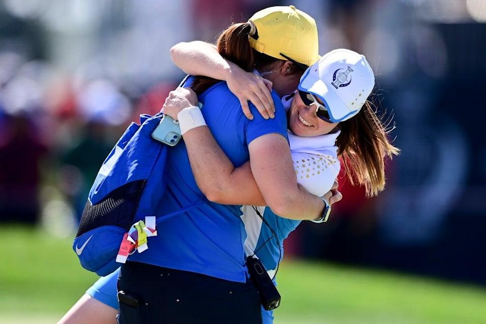 Europe's Leona Maguire (right) celebrates with her sister Lisa after beating Jennifer Kupcho in the Solheim Cup (David Dermer/AP) (AP)