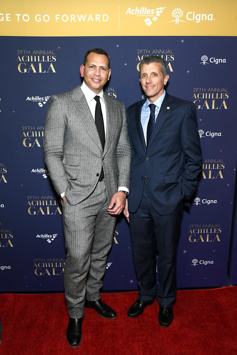 Cigna President and CEO David Cordani and baseball star Alex Rodriguez celebrate the courage of the Achilles International athletes at the Annual Gala.