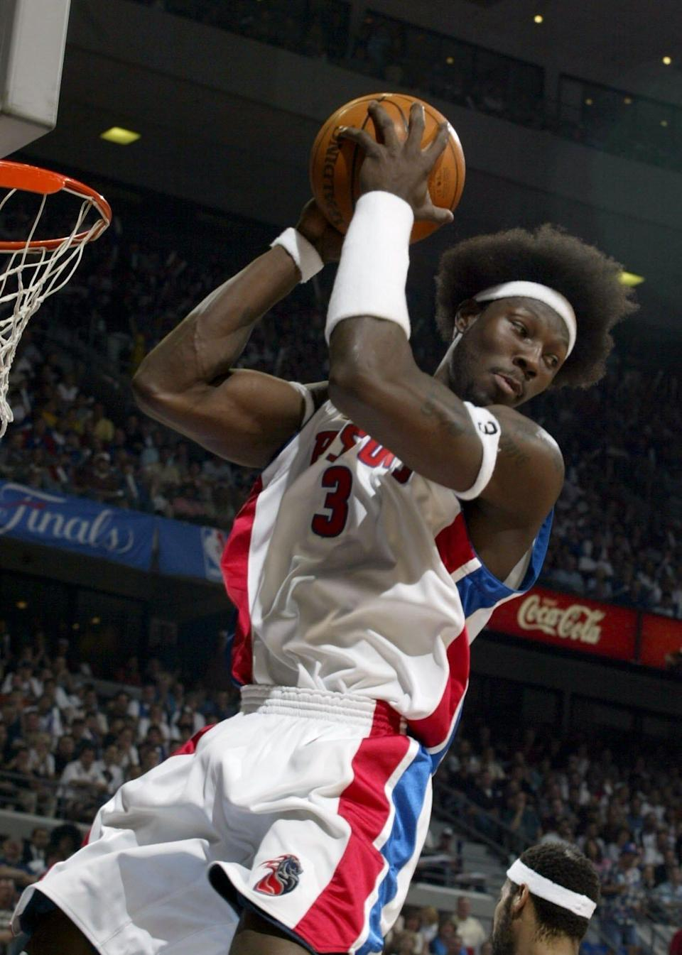 Detroit Pistons' Ben Wallace pulls in a rebound during the first quarter against the Los Angeles Lakers in Game 4 of the NBA Finals, Sunday, June 13, 2004, at the Palace of Auburn Hills,.