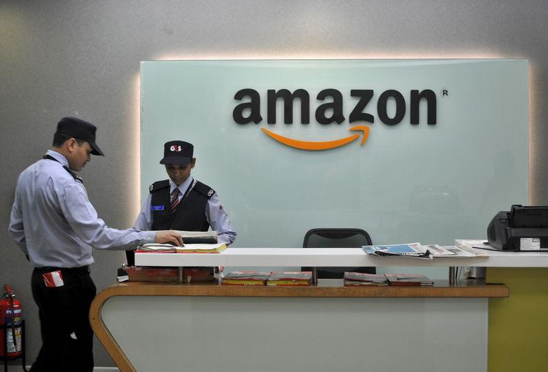 Security guards stand at the reception desk of the Amazon India office in Bengaluru