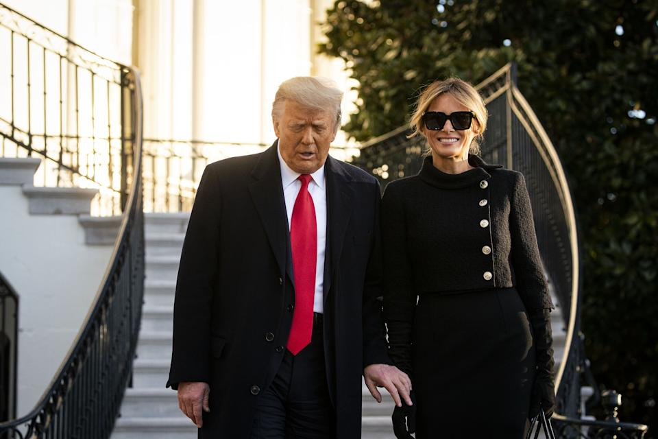 U.S. President Donald Trump, left, and U.S. First Lady Melania Trump exit the White House before boarding Marine One on the South Lawn in Washington, D.C., U.S., on Wednesday, Jan. 20, 2021. Trump departs Washington with Americans more politically divided and more likely to be out of work than when he arrived, while awaiting trial for his second impeachment - an ignominious end to one of the most turbulent presidencies in American history.