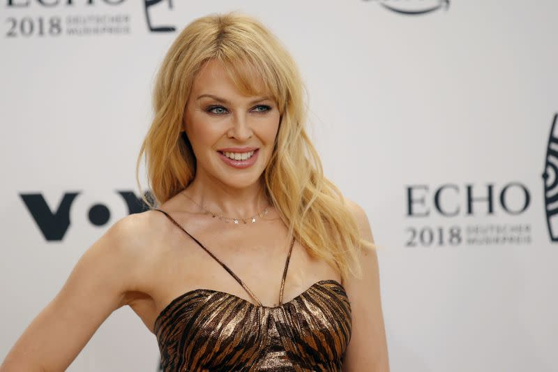 FILE PHOTO: Australian singer Kylie Minogue poses during a photocall upon arrival for the 2018 Echo Music Award ceremony in Berlin